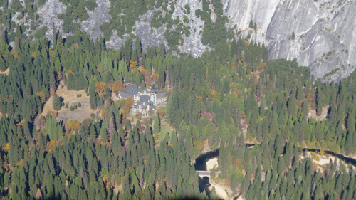 A view of the historic and grandeur Ahwahnee Hotel in the Yosemite National Park from Glacier Point.  It cost about half million dollars to build in 1925. Today this four-star rated hotel is in the hands of DNC, a concessionaire.